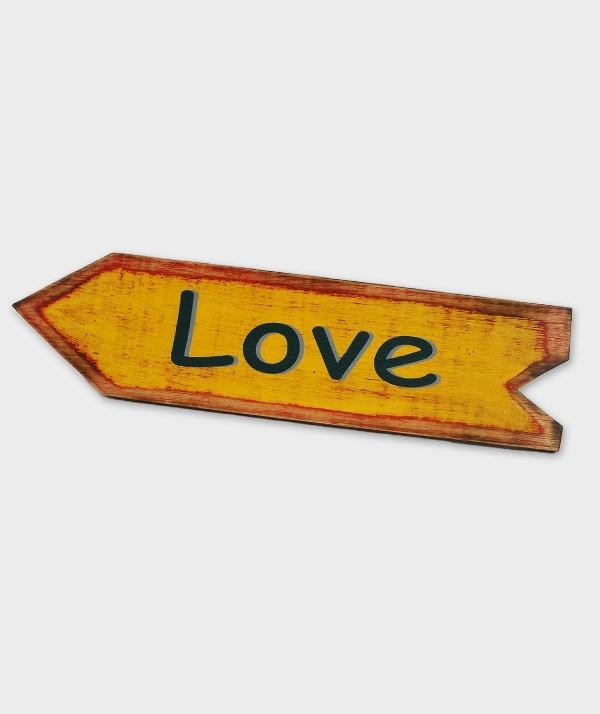 enseigne love flèche jaune